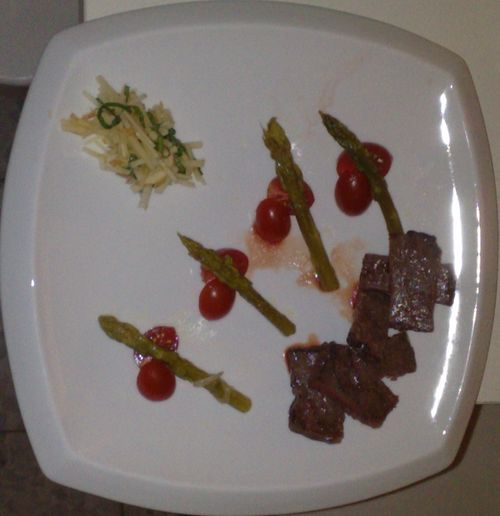 Grilled skirt steak, cherry tomatoes, poached asparagus with an apple-basil slaw.