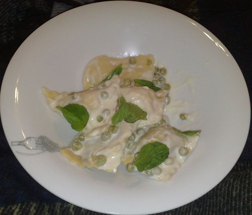 Meat and potatoes ravioli with cream sauce.