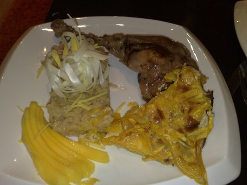 Japanese braised goose leg with herb infused rice, butternut squash gratin, leeks and mango.