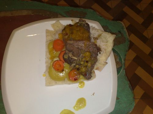Veal osso bucco with carmelized carrots, sunchoke and vadovan purée over moroccan bread.