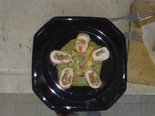 Chicken roll stuffed with mexican stirfry over cilantro purée topped with guacamole.